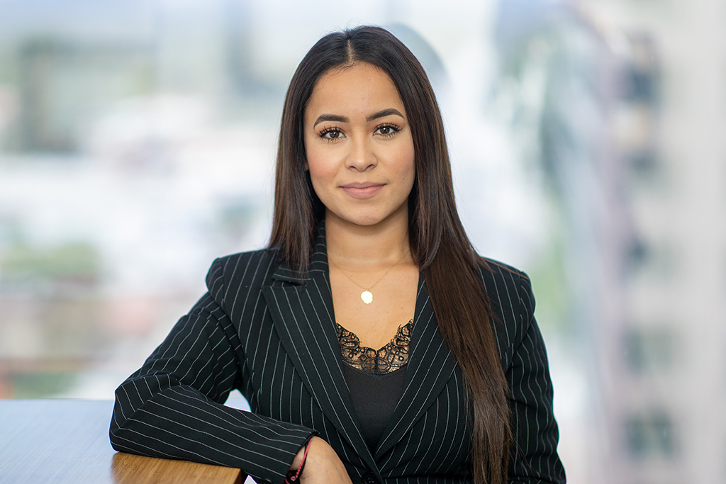 Esteisi Flores is a dedicated Paralegal at the Law Office of André J. Ausseresses